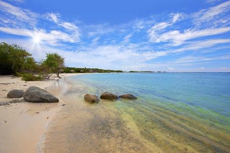 Turquoise water and beautiful beach on Baby beach, Aruba Stock Photo