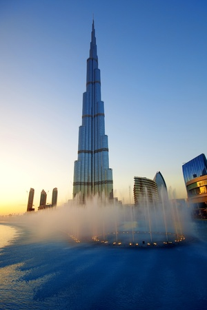 tallest: DUBAI, UAE - FEB 19: The Burj Khalifa, tallest building in the world, taken on February 19, 2011 in Dubai. In front is The Dubai Fountain show, a fountain system set on the 30-acre Burj Khalifa Lake.