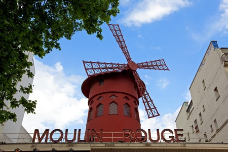 PARIS - MAY 2: The Moulin Rouge on May 02, 2011 in Paris, France. Moulin Rouge is a famous cabaret built in 1889, locating in the Paris red-light district of Pigalle