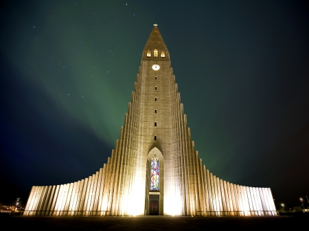 reykjavik: Northern lights  shining over the church in Reykjavik Stock Photo