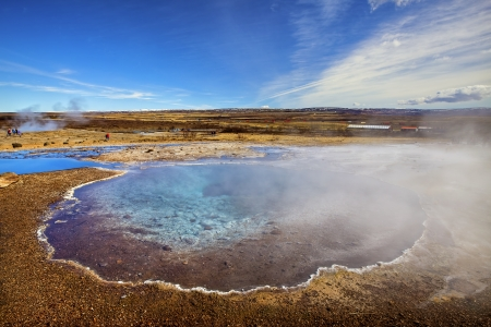 hot springs: Smoke rising from hot springs in Iceland Stock Photo