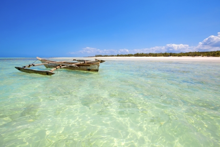 Crystal clear waters at Zanzibar beach in Tanzania photo
