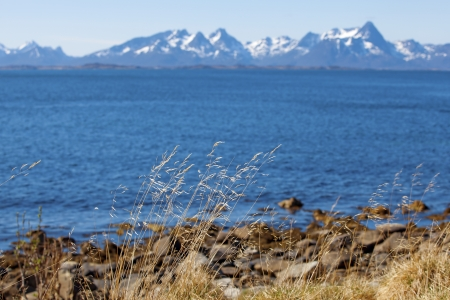 snowcapped: Snowcapped mountains and blue water, Norwegian fjord Stock Photo