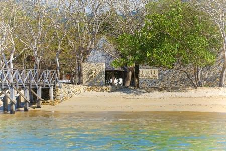 komodo island: The beautiful beach and pier on Komodo Island entrance Stock Photo