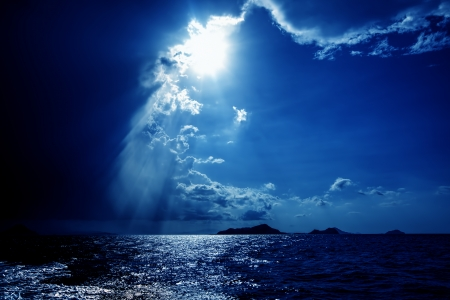 stormy sea: Sun bursting through dramatic skies over the ocean