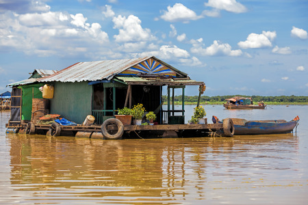 house float on water: The floating village on Tonle Sap lake