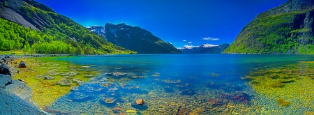 Panorama of a Norwegian fjord on a sunny day