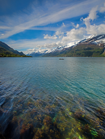 Fjords and snowcapped mountains in the beautiful Hardangerfjord
