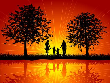 木の下で外を歩く家族のシルエット