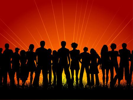 Énorme foule de gens au coucher du soleil