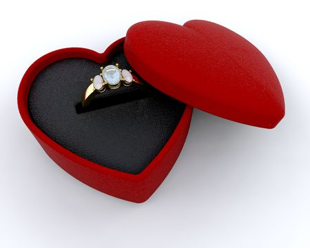 engagement ring: Engagement ring in a heart shaped box Stock Photo