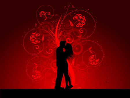 Silhouette of a kissing couple on a decorative background