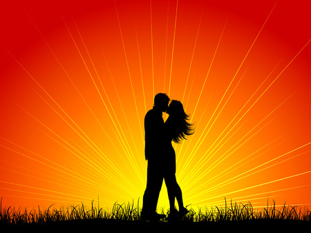 the season of romance: Silhouette of a couple kissing against a sunset sky