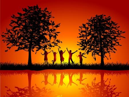 Silhouetten van kinderen buiten spelen naast een rivier Stockfoto