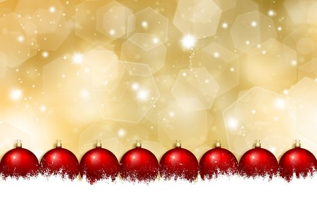 Christmas baubles in snow on a glittery gold Christmas background Stock Photo - 8053299