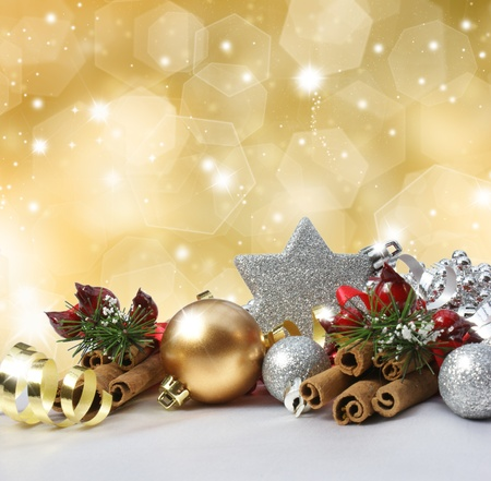 Christmas decorations on a glittery gold background photo