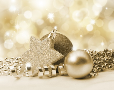Golden Christmas background with decorations and beads photo