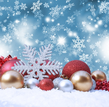 holiday season: Decorative christmas background with decorations in snow