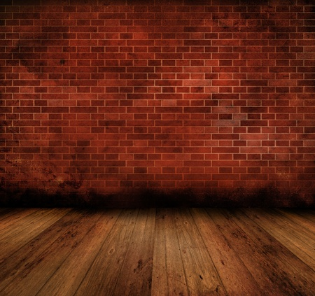 Grunge style image of an old interior with brick wall and wooden floor photo