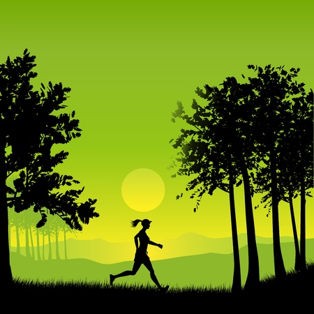 Silhouette of a female jogging in the countryside photo