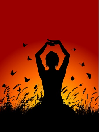 Silhouette of a female in a yoga pose against a sunset sky with butterflies flying around photo