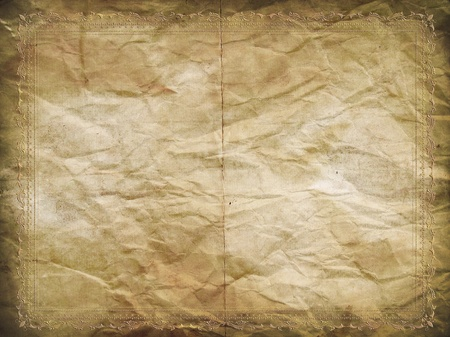 Grunge paper background with a decorative embossed border photo