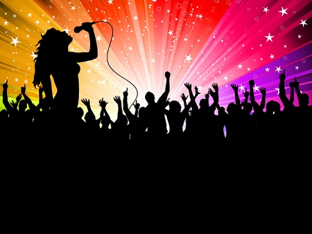 Silhouette of a female singer performing in front of a cheering audience photo