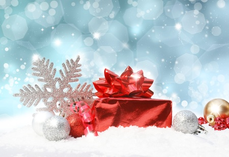 glittery: Glittery blue Christmas background with decorations in snow