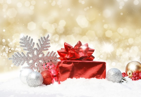 frost: Glittery gold Christmas background with decorations in snow