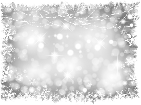 silver: Decorative silver lights Christmas background with snowy border Stock Photo