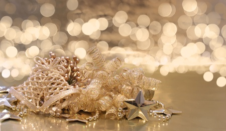 defocussed: Christmas background of golden decorations on a background of defocussed lights