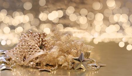 defocussed: Christmas background of golden decorations on a background of defocussed lights