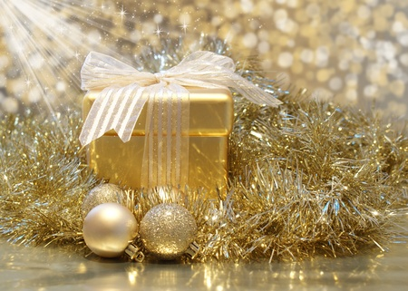 Christmas background with golden gift with sparkly stars Stock Photo - 11331522