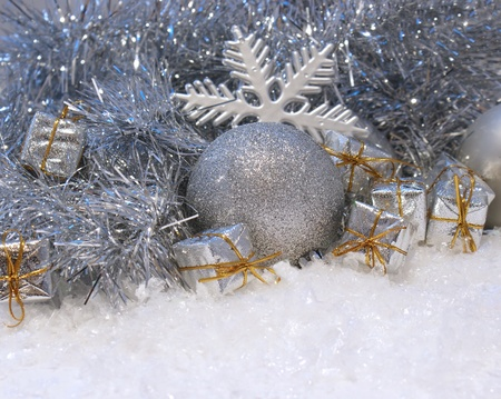 Christmas background with gifts and baubles nestled in snow photo