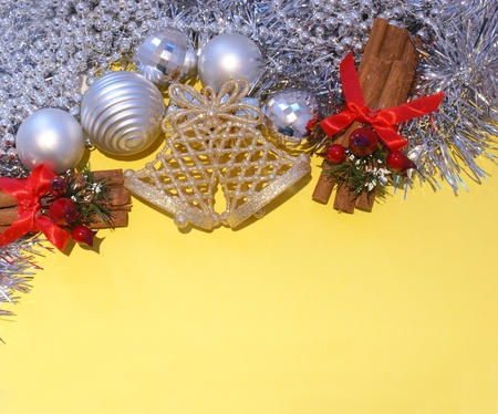 Christmas decorations on a bright yellow background photo