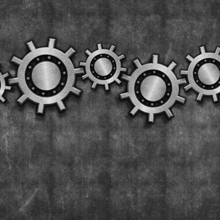 Interlocking gears on a grunge style background photo