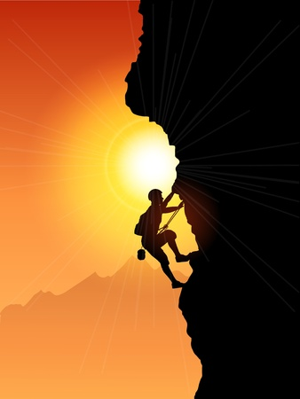 Silhouette of a rock climber against a sunset sky photo