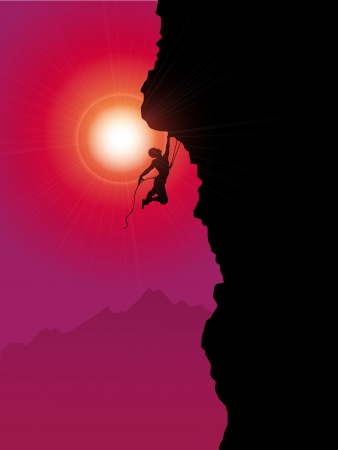 Silhouette of an extreme rock climber climbing a mountain photo