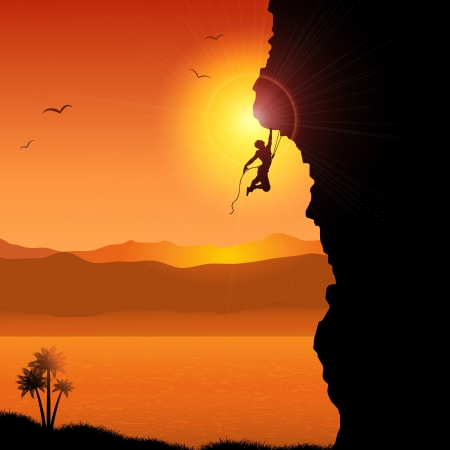 rock climbing: Silhouette of an extreme rock climber against a tropical landscape Stock Photo