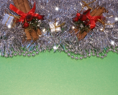 cinammon: Christmas decorations green background Stock Photo