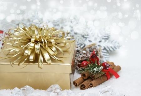 cinammon: Christmas background with gift and cinammon stick nestled in ice