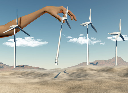 placing: 3D render of a female hand placing wind turbines in a desert