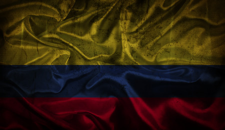 flag background: Colombian flag background with folds and creases and grunge effect Stock Photo