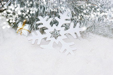 nestled: Christmas background with snowflake and gift nestled in snow Stock Photo