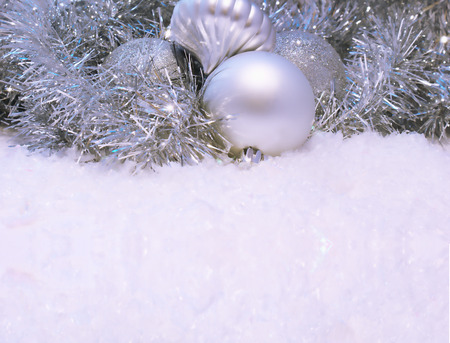 nestled: Christmas background with baubles nestled in snow