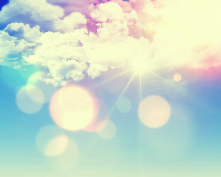 Sunny blue sky background with fluffy white clouds and retro effect added