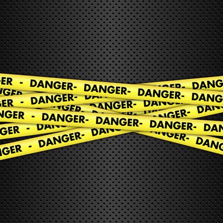 a danger: Yellow danger tape on a metallic background
