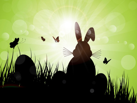 Sunset landscape vector: Silhouette of the Easter bunny sat in the grass Kho ảnh