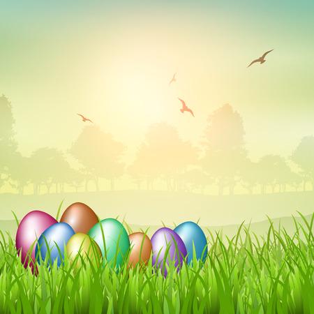 nestled: Colourful Easter eggs nestled in grass