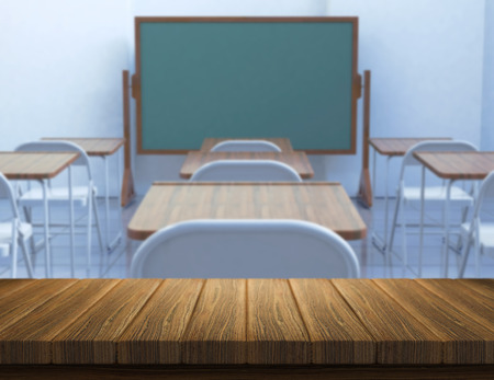defocussed: 3D render of a wooden table with a defocussed classroom in the background